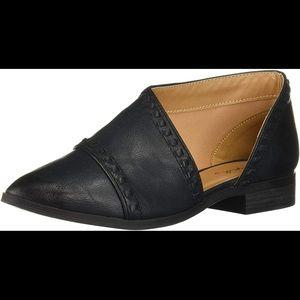 Asymmetrical studded slip on shoes